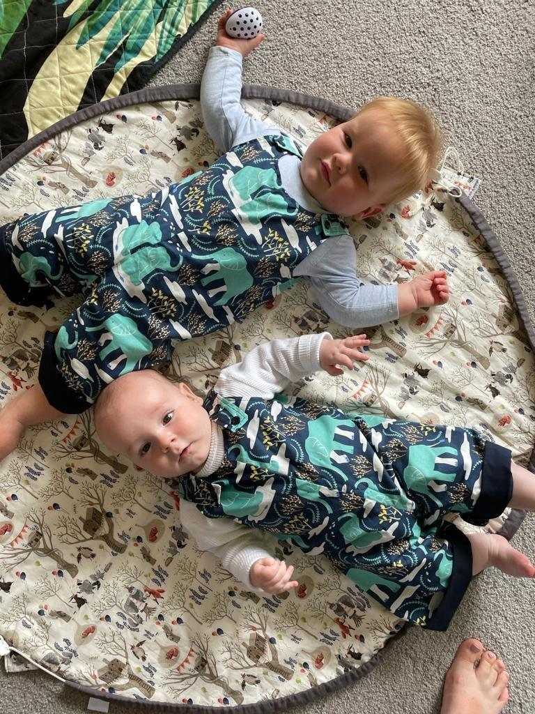 Cousins in matching Elephant Overalls